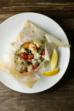 The key to tender, perfectly cooked fish? Break out that roll of parchment paper!