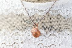 Check out this item in my Etsy shop https://www.etsy.com/listing/257782693/small-shell-pendant-copper-seashell