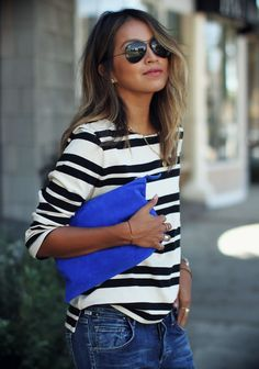 Casual stripes, denim, and a cobalt clutch.
