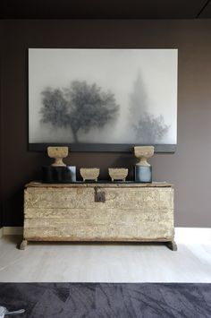 Moody vignette. Gorgeous wall art. Rustic side board and accessories. Interiors. Transitions. Neutral.