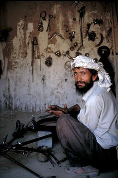Bicycle mechanic, in his shop. Kabul, Afganistan.