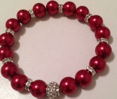 All red pearl bracelet with silver tone and crystal spacers