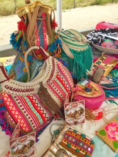 Hippie market Ibiza style filled with colorful bags