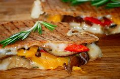 Grilled cheese with pita, roasted red/yellow peppers and mushrooms.