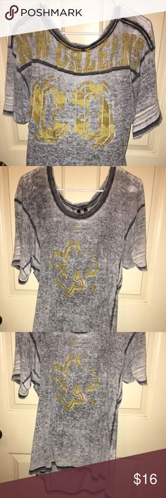 New Orleans Saints shirt New Orleans Saints grey shirt. Official NFL apparel. Worn once only. New condition. Smoke/pet free home. Love the longer length. Wore it with leggings. Super cute! Tops Tees - Short Sleeve
