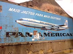 Old Pan Am billboard still around in Costa do Valado, Portugal. Pan Am, National Airlines, Vintage Travel Posters, Vintage Airline, Vintage Advertisements, Retro Advertising, Air Travel, Portuguese, Billboard