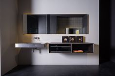 NAKED - Wall hanging washbasin in satin #steel and lateral units with recycled #wood finishes.