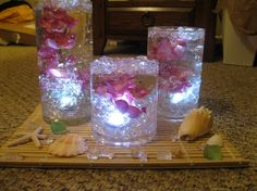 waterproof+candle+centerpieces | Bamboo placemats, waterproof LED lights, silk flowers, gel vase filler