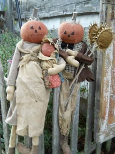 Primitive Pumkpkin head dolls set of 3 Momma,Pappa, and baby wrapped in old quilt