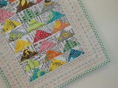 Very cute mini quilt with newsprint fabric