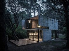 Designed by Argentinean architect Luciano Kruk, the Concrete Summer House is a distinctly modern structure, but looks perfectly at home in the wooded area of a beautiful natural space located in northern Argentina. Located among pine trees in the sea