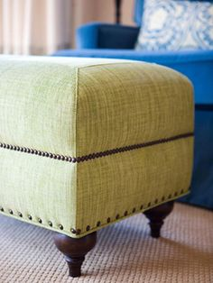 """Fun Lines on this piece. """"Customize Furnishings Dress up upholstered furniture with nail head trim. Even spacing between the nail heads is essential to creating a professional-looking piece, but try different spacing widths, like on this ottoman, to add visual interest."""""""