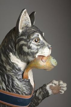 © 2006 Lance Keimig Photographics.  Detail of Heritage's carousel cat figure.  Dentzel cats were carved with either a fish, a bird, a crab or a squid in their mouths!