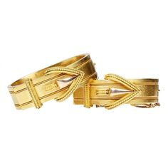 Victorian era matched set gold buckle bangles, 14k gold. The matched set together is a rare find. The buckle is a Victorian age symbol of strength and loyalty. English in origin. Circa 1860-80.