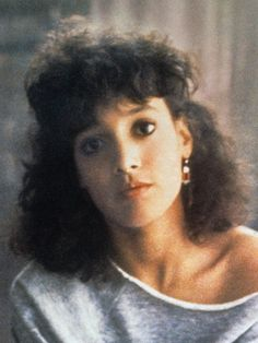 Those gorgeously fluffy curls. The headband. The off-the-shoulder sweatshirt. (OK, that has nothing to do with hair, but it really worked.) Who didn't want to be Jennifer Beals in the '80s? For Beals, the look came naturally. For the rest of us, there were perms and body waves.