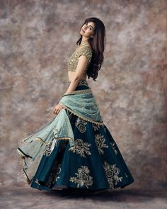 Stunning peacock blue color designer lehenga and gold sequence blouse with ice blue color net dupatta. Indian Bridal Outfits, Indian Bridal Lehenga, Indian Designer Outfits, Lehenga Choli Wedding, Choli Designs, Lehenga Designs, Stylish Dresses, Fashion Dresses, Designer Bridal Lehenga