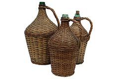 "Wicker Demijohn Bottles  Euro Linens  Large: 11""W x 18""H  Medium: 8""D x 16""H  Small: 8""D x 15""H  ($265.00)  $145.00 OneKingsLane.com"