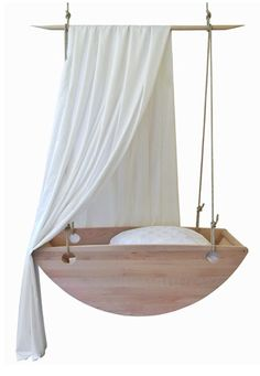 Wiege- hanging baby bassinet that becomes a sailboat later