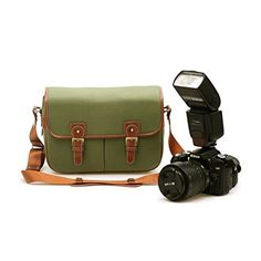 Zlyc Waterproof Vintage Faux Leather and Canvas Camera Bag Messenger Bag for DSLR Camera and Lens ZLYC http://www.amazon.com/dp/B00L9TIY0E/ref=cm_sw_r_pi_dp_sioRtb0Q7F0DD0CK