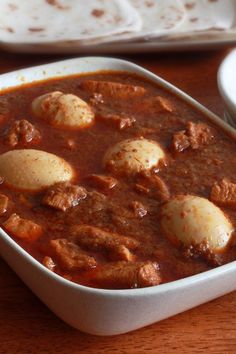 Doro Wat. Definitely wanna make this sometime. Would use ghee instead of butter, no honey with the white wine...and love the hard boiled eggs!