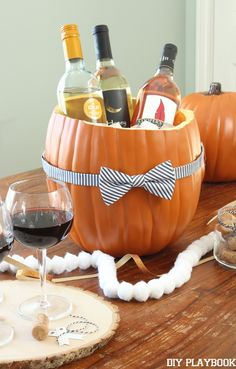 How to make a pumpkin cooler for a Halloween Party this fall. Such an easy way to make your entertaining and tablescape much more festive!
