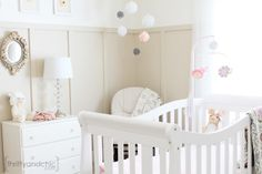 Neutral girl nursery - Love the craftsman style wainscoting.