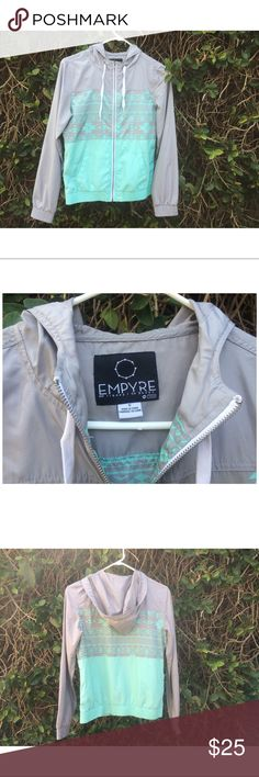 Empyre teal and gray wind breaker jacket Empyre teal and gray wind breaker jacket. Size small. Has a good. Has a small ink dot on the back. Sold as is empyre Jackets & Coats