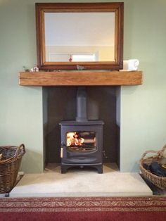 C-Five Scabbled Yorkshire stone hearth, oak fireplace beam.jpg