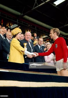 Captain Bobby Moore shakes the hand of Queen Elizabeth II as he accepts the Jules Rimet trophy after the World Cup Final between England and West Germany at Wembley Stadium on July 1966 in. School Football, Football Shirts, Football Team, Jules Rimet Trophy, 1966 World Cup Final, Bobby Moore, England International, World Cup Winners, Most Popular Sports