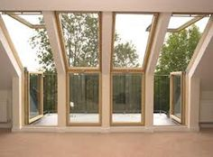 tiny #attic conversion - back, overlooking 2nd level balcony. Love the use of the #windows