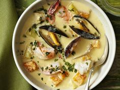 Peruvian Seafood Chowder- Seafood dishes always have a place on the holiday table. This seafood chowder is rich, hearty and full of flavor, but as a main dish, it's low in calories. - The Food Network Seafood Soup, Seafood Dishes, Fish And Seafood, Chowder Recipes, Soup Recipes, Cooking Recipes, Fish Recipes, Seafood Recipes, Party Recipes