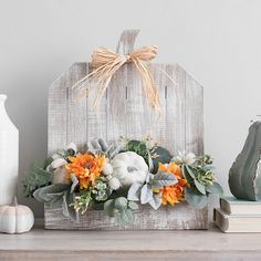 Create a beautiful tabletop or mantel design for harvest season using our Pumpkin and Daisy Floral Arrangement! You'll love how it pops next to your fall decor. Harvest Decorations, Thanksgiving Decorations, Thanksgiving 2016, Holiday Decorations, Wood Pumpkins, Fall Pumpkins, Fall Crafts, Decor Crafts, Fall Flower Arrangements