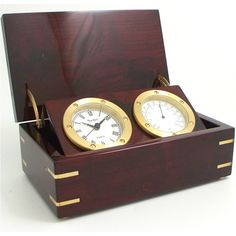 Clock and Weather Instruments - Quartz clock and thermometer in rosewood box with brass accents.
