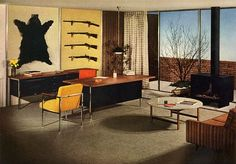 With the bear rug and guns, this must be a bachelor pad, but a man with an eye for colour and sideboards.