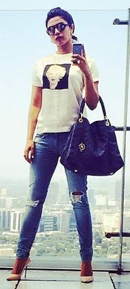 Priyanka Chopra looks cool in washed-out denims and a basic tee!