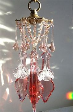 Renee, I have found this pretty Pink Wind Chime for you. It will play beautiful music when the wind blows and light will dance all around where it is hung. I hope you find a pretty spot to hang it. Crystal Wind Chimes, Glass Wind Chimes, Diy Wind Chimes, Mobiles, Blowin' In The Wind, Crystal Design, Sun Catcher, Stained Glass Art, Yard Art