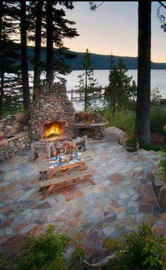 Picnic table, fireplace, stone patio on a lake - doesn't get much better than that.  :D