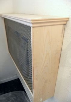 great way to cover up an ugly airconditioner and you can add items on the top shelf.