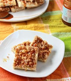 Caramel Apple Cheesecake Bars - It doesnt have to be fall in order to enjoy an apple dessert. Recipes with apples are good any time of year! Take, for instance, these Caramel Apple Cheesecake Bars. You probably want to make them right now. A cinnamon and brown sugar crust, apple cheesecake filling, and caramel streusel topping make these bars out of this world.