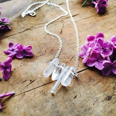 A personal favorite from my Etsy shop https://www.etsy.com/listing/278154486/crystal-bead-dangle-necklace-with-silver
