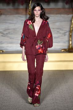 """Matthew Williamson Look 1 SS15 Suede Kimono Jacket And Trousers. """"I love the tropical hibiscus embroidered flowers embellishing the jacket but what I like even more is the fact that it's on suede and in damson, a more autumnal hue. I like that it's a more off-beat colour for summer and the unstructured feel of the jacket lends it a relaxed feel."""" - Deborah Brett"""