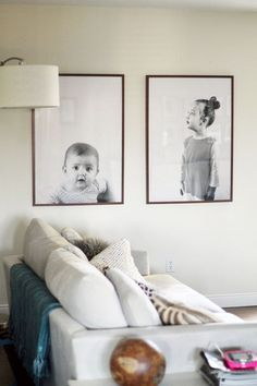 Gone are the days of the piano or bay window lined with family photos  framed in maple and propped up to collect dust. But, you still want to  display your treasured photos, so why not try one of these modern  suggestions below?  Oversized Prints -  If you saw my post last week, you know that I'm feeling the oversized  portraits. I love these engineer prints, for a couple of bucks you can  have fabulous modern family photos.  Graphic Gallery Wall -  More than the mix-and-match gallery…