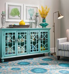 The new Darcy credenza is cute, chic and full of character. Its bayberry blue textured finish is perfectly distressed, making it look like an heirloom that's been passed down through generations. The glass doors feature a geometric lattice design for plenty of visual interest. To top it all off, antiqued brass hardware and turned feet offer even more classic charm.