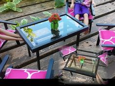 How to make a Barbie Doll Sized Patio Table.  The same person has videos for matching chairs and a swing, and among other things, a SNOWBLOWER!