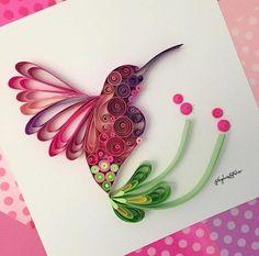 This beautiful work of paper quilling art will impress your friends to the fullest. This paper quilled humming bird is cute and wonderful. The colors chosen are giving it a bright and natural impact. Your selection of colors matters a lot in paper quilling and enhances the beauty of the filigree.