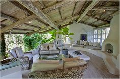 Open. Love the curved stucco, exposed wood beams and arching roof...Love it all