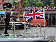 A Sailor stands in formation at the head of HMS Trumpeter as she passes the massed crowds on the banks of the Thames. Picture: LA(Phot) Simpson    Her Majesty The Queen and His Royal Highness The Duke of Edinburgh were onboard the Royal Barge, the Spirit of Chartwell with several other members of the Royal Family to celebrate the Queen's Diamond Jubilee at the River Pageant on the Thames River.