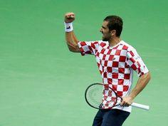 El croata Cilic celebra la victoria de su equipo en las semifinales de Copa…
