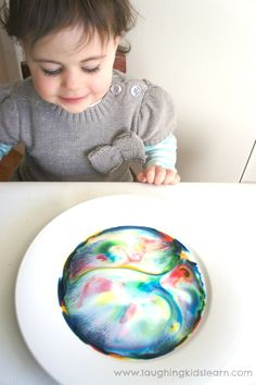 Lots of colours in this science experiment about color with Magic Milk