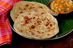 Parotta, a popular street food of Tamil Nadu and Kerala. A layered flat bread that is soft and flaky served with vegetable salna or chicken curry.